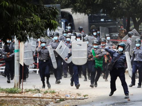 Police charge forward to disperse protesters in Mandalay, Myanmar (AP Photos)