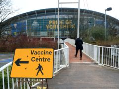 A sign to a vaccine centre near the John Smith's Stadium, Huddersfield (Mike Egerton/PA)