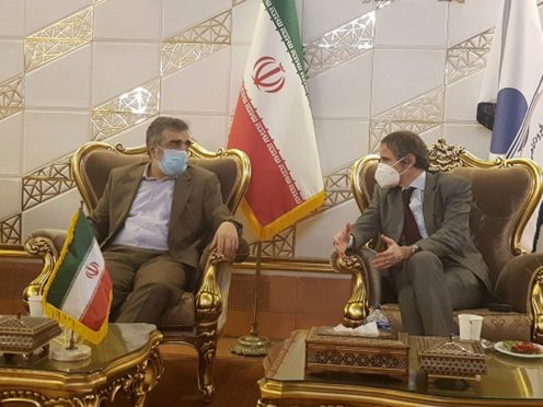 IAEA director-general Rafael Mariano Grossi, right, speaks with Iranian atomic agency official Behrouz Kamalvandi (Atomic Energy Organisation of Iran/AP)