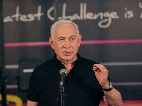 Israeli Prime Minister Benjamin Netanyahu talks to the media during a visit to the Fitness gym in Petah Tikva, Israel, ahead of its reopening (Tal Shahar/Yediot Ahronot/Pool/AP)