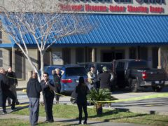 Jefferson Parish Sheriff's Office deputies investigate a shooting at the Jefferson Gun Outlet in Metairie, Louisiana (Sophia Germer/The Times-Picayune/The New Orleans Advocate via AP)