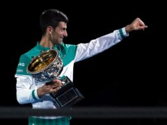 Novak Djokovic holds the Norman Brookes Challenge Cup for a ninth time (Mark Dadswell/AP)