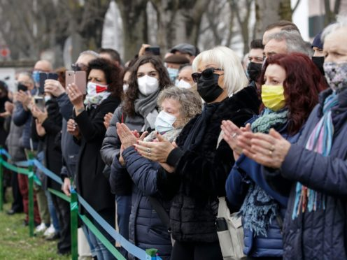 Residents of Codogno, northern Italy, attend the unveiling of a memorial for Covid deaths (Luca Bruno/AP)