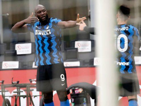 Lautaro Martinez, right, scored twice and Romelu Lukaku, left, sealed matters at the San Siro (Antonio Calanni/AP)