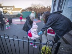 Nursery pupils arriving for their first day back at Inverkip Primary School in Inverclyde as Scotland's youngest pupils return to the classroom as part of a phased reopening of schools (PA)
