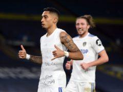 Raphinha celebrates scoring Leeds' third goal of the game (Gareth Copley/PA)