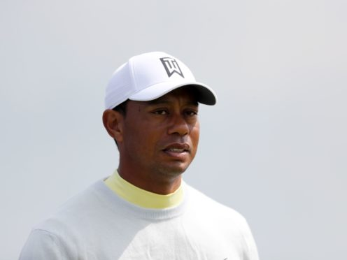 Tiger Woods is 'in good spirits' after being moved to a new hospital in Los Angeles for treatment from multiple injuries sustained in a serious car accident (Niall Carson/PA)