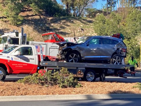 The vehicle driven by Tiger Woods on the back of a truck in Los Angeles after he suffered leg injuries when the vehicle rolled over and is now in hospital undergoing surgery (Keiran Southern/PA)