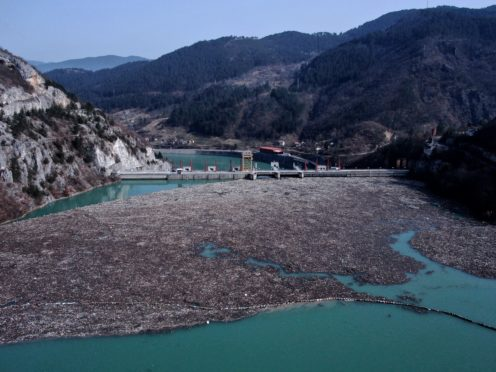 An aerial photo shows rubbish floating in a river in Bosnia (Kemal Softic/AP)
