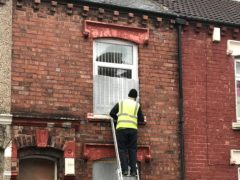 The terraced house in Percy Street, Middlesbrough, reported to be a crack den, being boarded up (Middlesbrough Council)