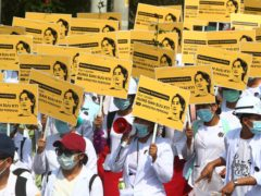 Medical students display images of deposed Myanmar leader Aung San Suu Kyi (AP)