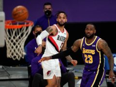The Portland Trail Blazers suffered their fourth consecutive loss as the Los Angeles Lakers took control in the third quarter and pulled away for a 102-93 victory with LeBron James, right, scoring 28 points (Mark J Terrill/AP)