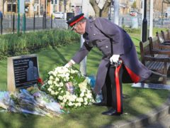 David Pearson, Deputy Lieutenant for West Yorkshire lays a wreath (Danny Lawson/PA)