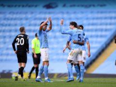 Manchester City goalscorers Ruben Dias and John Stones (Gareth Copley/PA)