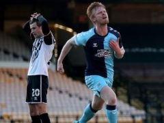 Liam O'Neil celebrates after scoring a late winner for Cambridge at Port Vale (Bradley Collyer/PA)