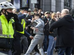 Protesters clashing with Gardai during an anti-lockdown protest in Dublin city centre (Damian Eagers/PA)