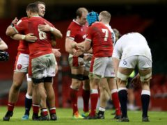 Wales' Rhodri Jones and Taulupe Faletau (back to camera) celebrate victory over England (David Davies/PA).