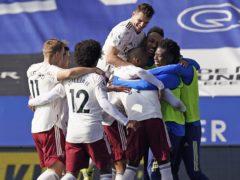 Nicolas Pepe (hidden) is mobbed after scoring Arsenal's third goal (Tim Keeton/PA)