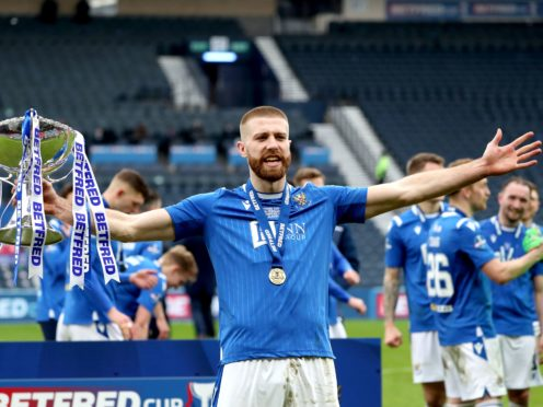 Shaun Rooney celebrates with the Betfred Cup trophy (Andrew Milligan/PA)