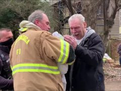 A man and his dog are reunited after a fire (Chattanooga Fire Department/PA)