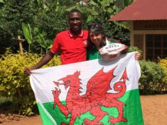 Rwandan international wing Donatien Ufitimfura poses with Mary Watkins (Friends of Rwandan Rugby/PA)
