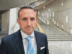 Liberal Democrat Alex Cole-Hamilton apologised unreservedly to children's minister Maree Todd (Tom Eden/PA)