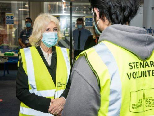 Royal Voluntary Service President, HRH The Duchess of Cornwall, speaks to Shaviaz Mir, NHS, volunteer responder steward at Wembley Vaccination Centre (Royal Voluntary Service/PA)