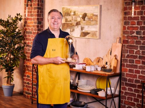 Ed Balls, winner of Celebrity Best Home Cook, holds the Golden Spoon trophy ( BBC/KEO Films/PA)
