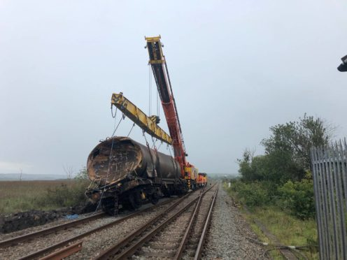 A railway line has reopened following a six-month operation to avert 'total environmental disaster' after a freight train derailed, caught fire and spilled 350,000 litres of diesel, Network Rail said (Network Rail/PA)
