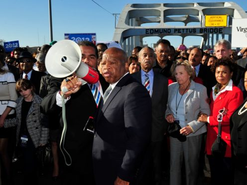 John Lewis, centre, talks with people gathered on the historic Edmund Pettus Bridge during the 19th annual re-enactment of the 'Bloody Sunday' Selma to Montgomery civil rights march across the bridge in Selma, Alabama, on March 7 2012 (Kevin Glackmeyer/AP)