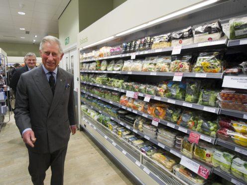 The Prince of Wales visiting Waitrose supermarket in Poundbury, Dorset, in 2011 (Arthur Edwards/The Sun/PA)