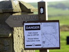 Two adults and a child who set up a tent on the top of a 280ft cliff along the Cleveland Way in North Yorkshire had 'no idea of the extreme danger they were in', Coastguards said (John Giles/PA)