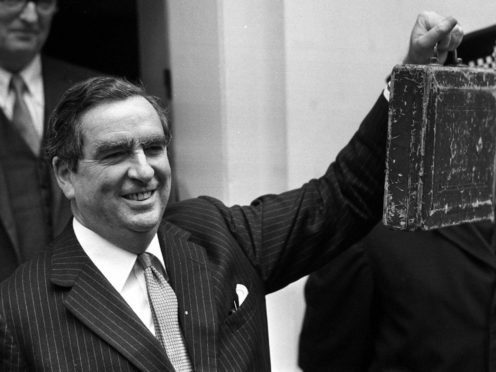 Denis Healey holds his Budget box outside 11 Downing Street in March 1974 (PA)