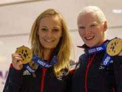 Great Britain Paralympians Charlotte Evans, left, and Kelly Gallagher show off their gold medals at Heathrow Airport (Steven Parsons/PA)