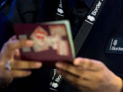 Passport staff at Heathrow have called off a planned strike (Steve Parsons/PA)
