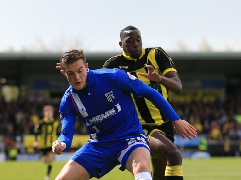Brennan Dickenson, left, will miss out for Carlisle (Nigel French/PA)