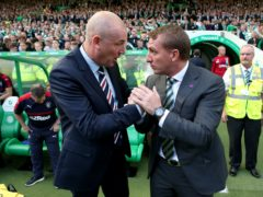 Rangers manager Mark Warburton (left) could not stop Celtic's rampant run under Brendan Rodgers – now he says it is time the Light Blues built a dynasty of dominance (Andrew Milligan/PA)