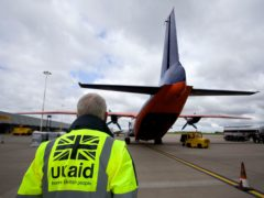 Staff from UK Aid watch as cargo is loaded on to an Antonov An-12B aircraft at East Midlands Airport (Simon Cooper/PA)