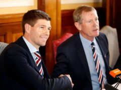 Dave King, right, believes Steven Gerrard will not quit Rangers for Liverpool in the near future (Jeff Holmes/PA)