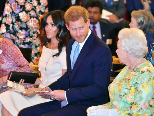 Queen Elizabeth II with the Duke and Duchess of Sussex at the Queen's Young Leaders Awards Ceremony at Buckingham Palace, London.