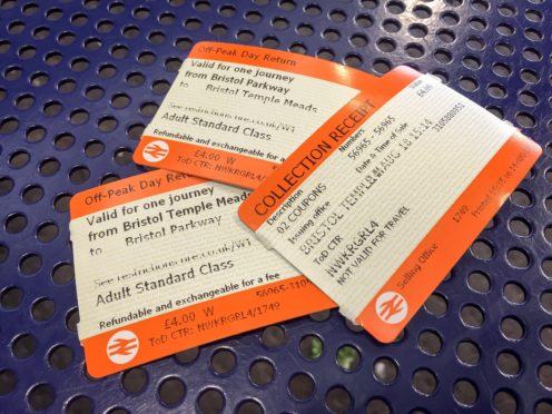 Rail passengers in England and Wales have been hit by above inflation fare rises despite the collapse in demand (Ben Birchall/PA)