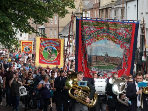 Bands and banners parade through Durham during the Durham Miners' Gala (Owen Humphreys/PA)