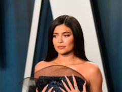 Kylie Jenner has responded to the backlash over her support of a makeup artist's GoFundMe page (Ian West/PA)