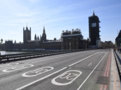 An empty Westminster Bridge and the Houses of Parliament in Westminster, London, the day after Prime Minister Boris Johnson put the UK in lockdown to help curb the spread of the coronavirus (Stefan Rousseau/PA)