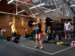 Gym members exercise (John Walton/PA)