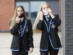 Students put on protective face masks (PA)