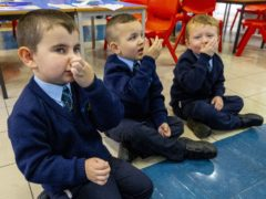 (left to right) Ronan Girvan, Leo Di Vecsi and Oisin Hicks mimick what to do when they need to sneeze (Liam McBurney/PA)