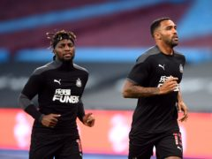 Ciaran Clark believes Allan Saint-Maximin, left, and Callum Wilson, right, can keep Newcastle in the Premier League (Michael Regan/PA)