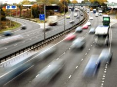 File photo dated 26/10/09 of drivers on a motorway. Half of drivers were spending less time on the road than normal even before new lockdown restrictions were announced, a survey suggests.