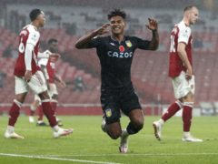 Ollie Watkins has gone from Exeter, right, to the Premier League and now England (Alastair Grant/David Davies/PA)